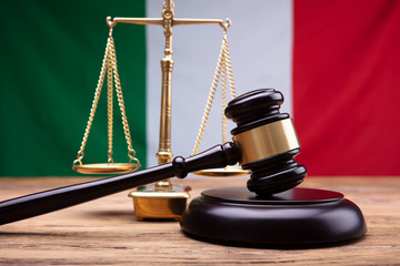 Italian Flag Behind Justice Scale And Mallet