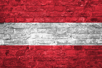 Flag of Austria over an old brick wall background, surface