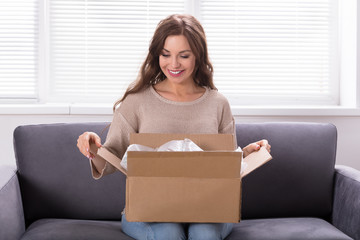 Woman Unpacking Received Parcel