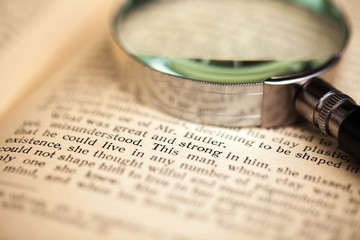 Loupe on Open Old Book - Close Up