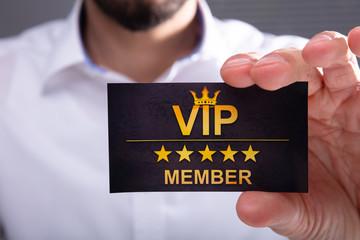 Businessman Showing VIP Member Card