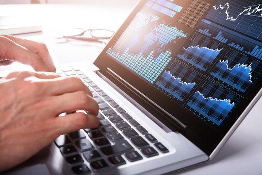 Businessman Analyzing Graph On Laptop