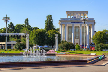 Pavilion National education on Exhibition of Achievements of National Economy (VDNH) in Moscow against Fountain Friendship of peoples in sunny summer morning
