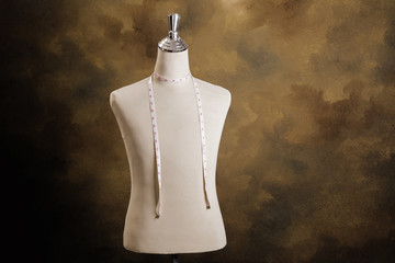 Mannequin with measuring line on brown background.Horizontal appearance