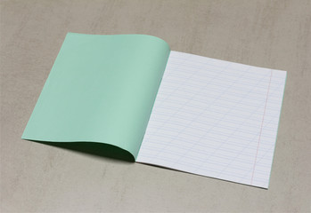 open school notebook in a narrow line with a slash for learning spelling, mock up with copy space on a gray background