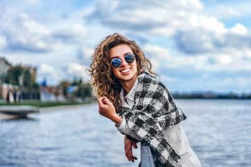 Cute girl with curly hair near lake
