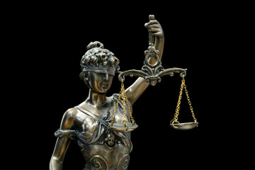 Themis or Lady Justice (Symbol of Justice) isolated on black background with clipping path
