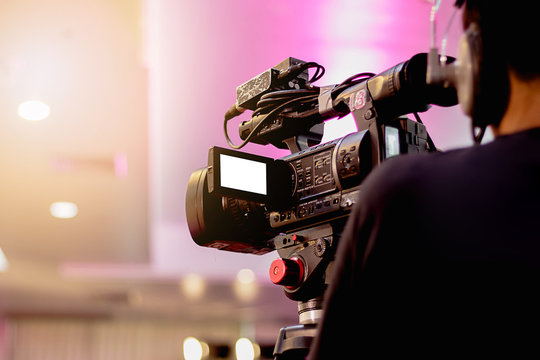 professional cameraman - covering on event with a video