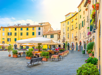 Cafe in the cozy morning lighted square of the city side. Italy. Europe
