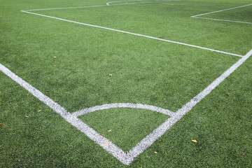 Closeup of Football and soccer field corner with white