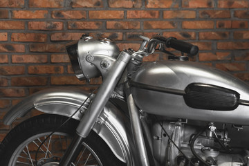 motorcycle on the brick wall of background