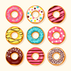 Pink donut, chocolate donut, lemon and blue mint donuts with different topping on white background