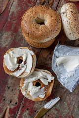 everything bagels with cream cheese on rustic painted table