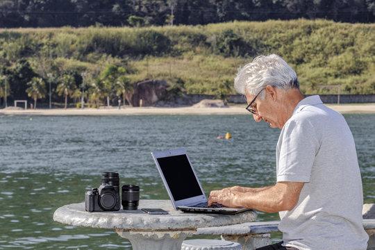 senior man working on the beach