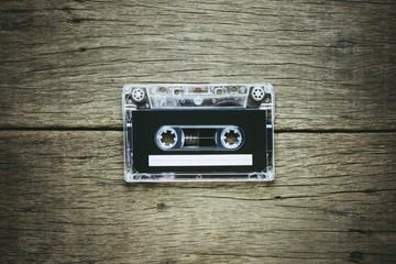 vintage audio cassette tapes on wooden background. - vintage backdrop style.