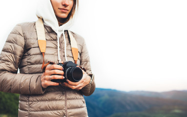 photographer traveler on green mountain, tourist holding in hands digital photo camera closeup, hiker taking click photography, nature panoramic landscape in trip, relax holiday hobby concept