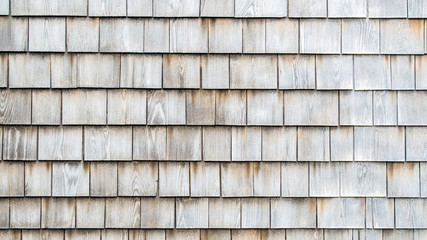 background texture close up of weathered wooden shingles on a vintage colonial building in Massachusetts