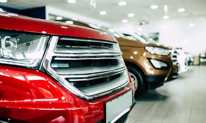 View of row new car at dealership indoors