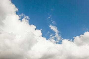 deep blue sky with big fluffy white cloud