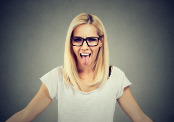 Rebel woman showing tongue out