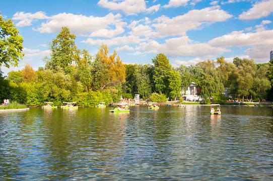 Locals relax in Neskuchny Garden around Golitsyn (large) pond during midday.