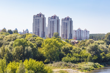 high-rise apartment buildings in the middle of the forest