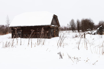 abandoned shed in old russian village in winter