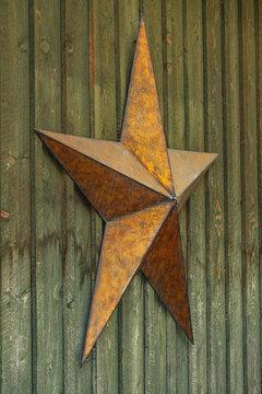 country rusty metal star on barn