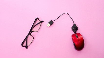 Minimal workplace with computer mouse and  glasses copy space on pastel background. Top view. Flat lay.