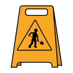 color plastic caution emblem and laborer with shovel
