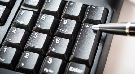 Wall Mural - Number keyboard of computer with pen close up