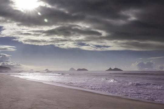 Sunny morning over the cloudy sky on the beach in Rio de Janeiro Brazil