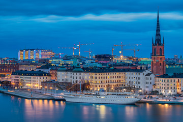 Sunset view onto Stockholm old town Gamla Stan and Riddarholmen church in Sweden