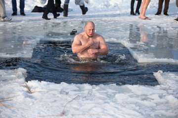 Belarus, Gomel, January 19, 2017. Lake Chernoye. Epiphany. Bathing in the ice hole. Plunge into the ice water