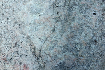 Granite texture for the designer. Granite stone close up. Background of natural material. Rocky rocks of ancient times. Natural pattern