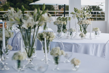 A very nicely decorated wedding table with plates, serviettes and signs. Scandinavian style. Sample and clean.
