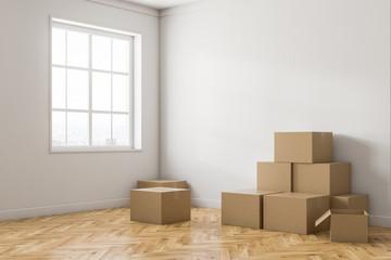 Empty white room corner with boxes