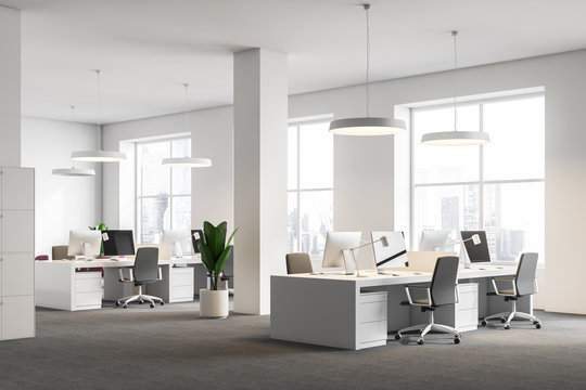 White office corner, columns, computer desks