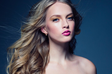 Beautiful blonde woman with pink lipstick beauty model