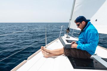 Man working on sail yacht