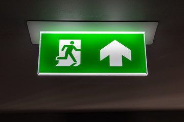 Fire exit ,green emergency exit sign Wall mural