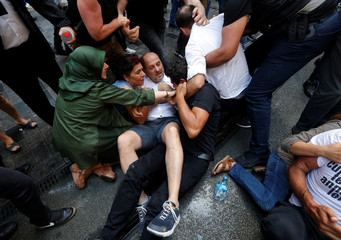 Pro-Kurdish Peoples' Democratic Party (HDP) lawmakers scuffle with the police as they prevent Saturday Mothers' 700th gathering in central Istanbul