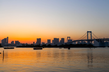 View of sunset and three boats and rainbow bridge at sumida river sunset viewpoint ,tokyo