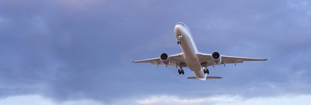 Commercial passenger jet aircraft landing at the airport.