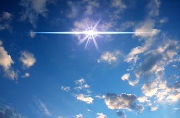 Wall Mural - cloudy sky with magic flare star like mystic, divine, angelic, magic background