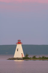 Wall Mural - Kidston Island Lighthouse at sunset in Baddeck, Nova Scotia