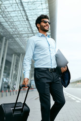 Business Trip. Man Traveling With Case At Airport