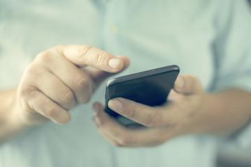 Close-up view. Man using a phone. Selective focus