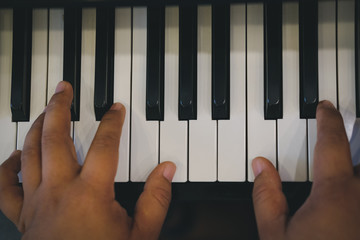 pianist man's hand playing piano. performer & classic music instrument
