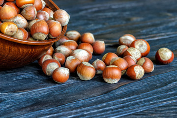 whole hazelnuts on the background of a wooden table